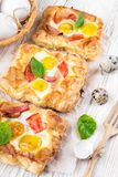 Pie of quail eggs with tomato Stock Photo