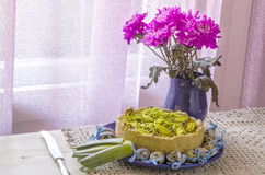 Pie quiche with leeks, cheese on linen tablecloth Royalty Free Stock Image