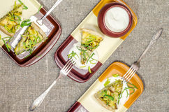 Pie quiche with leeks, cheese on linen tablecloth Royalty Free Stock Images