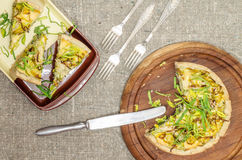 Pie quiche with leeks, cheese on linen tablecloth Stock Images