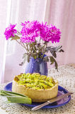 Pie quiche with leeks, cheese on linen tablecloth Royalty Free Stock Photos