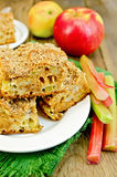 Pie rhubarb and apple on a wooden board Stock Image