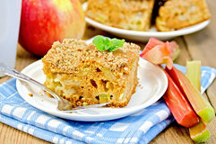 Pie with rhubarb and apples on the board Stock Photos