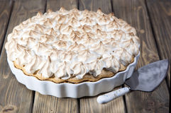Pie with slices of peach and meringue Stock Images