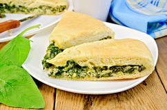 Pie spinach and cheese on board with knife Royalty Free Stock Photo