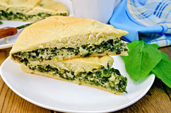 Pie with spinach and cheese on the board Royalty Free Stock Photo