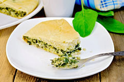 Pie spinach and cheese with fork on board Royalty Free Stock Photo