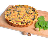 Pie with spinach and ham on the board. Isolated. Pie with spinach and ham on the board. Isolated Stock Photo