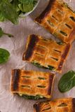 Pie with spinach and ricotta cheese. Pie with spinach and ricotta cheese on wooden table stock images