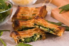 Pie with spinach and ricotta cheese. Pie with spinach and ricotta cheese on wooden table royalty free stock image
