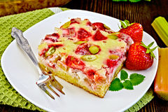 Pie strawberry-rhubarb with sour cream on dark board Stock Images