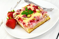 Pie strawberry-rhubarb with sour cream and fork on board Royalty Free Stock Images