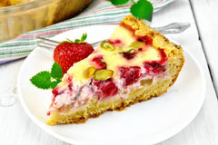 Pie strawberry-rhubarb with sour cream on light board Royalty Free Stock Images
