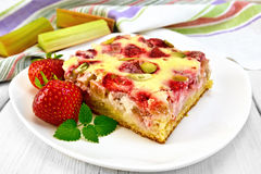 Pie strawberry-rhubarb with sour cream and mint on board Royalty Free Stock Photo