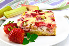 Pie strawberry-rhubarb with sour cream and napkin on board Royalty Free Stock Image