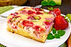 Pie strawberry-rhubarb with sour cream on napkin Royalty Free Stock Photos