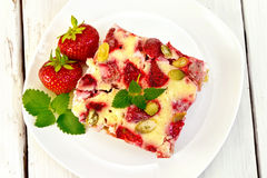 Pie strawberry-rhubarb with sour cream on plate Stock Photo