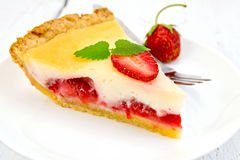 Pie strawberry with sour cream on light board stock images
