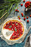 Pie with strawberry on vintage blue background. Stock Photo