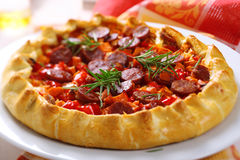 Pie with sweet potato, sausage and pepper Stock Images