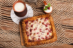 Pie on the table with food set Stock Photography