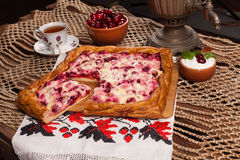 Pie on the table with food set Royalty Free Stock Image