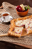 Pie on the table with food set Royalty Free Stock Images