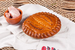 Pie on the table with food set Royalty Free Stock Photo