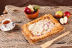Pie on the table with food set Royalty Free Stock Photography