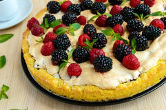 Pie (Tart) with fresh blackberries and raspberries, air meringue, decorative mint. Close up Royalty Free Stock Photos