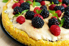 Pie (Tart) with fresh blackberries and raspberries, air meringue, decorative mint. Close up Stock Photo