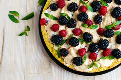Pie (Tart) with fresh blackberries and raspberries, air meringue, decorative mint. Close up. Royalty Free Stock Photo
