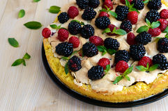 Pie (Tart) with fresh blackberries and raspberries, air meringue, decorative mint. Close up. The top view Stock Images