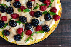 Pie (Tart) with fresh blackberries and raspberries, air meringue Stock Photo