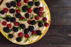 Pie (Tart) with fresh blackberries and raspberries, air meringue Royalty Free Stock Photography