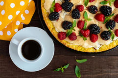 Pie (Tart) with fresh blackberries and raspberries, air meringue, decorative mint and cup of coffee. Stock Image