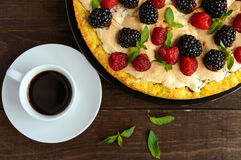 Pie (Tart) with fresh blackberries and raspberries, air meringue, decorative mint and cup of coffee. Pie (Tart) with fresh blackberries and raspberries, air Stock Image
