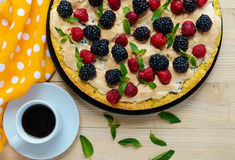 Pie (Tart) with fresh blackberries and raspberries, air meringue, decorative mint and cup of coffee. Pie (Tart) with fresh blackberries and raspberries, air Royalty Free Stock Photos