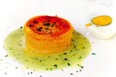 Pie in tomato sauce with aromatic herbs Stock Photos