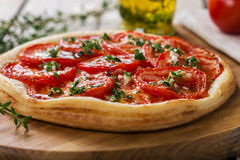 Pie with tomato tart Stock Images