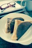 Pie triangular shape on white dish,vintage effect filter Stock Image