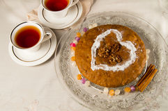 Pie and two cups of tea on the table Royalty Free Stock Photography