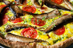 Pie with vegetables and sprats Royalty Free Stock Images