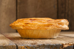 Pie on Wooden Background Shot at Neutral Angle Royalty Free Stock Photography