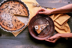 Pie on a wooden table. Baked cake in a ceramic form sprinkled with chocolate slices on a wooden table. rural style. still life Royalty Free Stock Photography