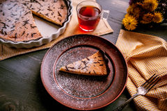 Pie on a wooden table. Baked cake in a ceramic form sprinkled with chocolate slices on a wooden table. rural style. still life Royalty Free Stock Photos