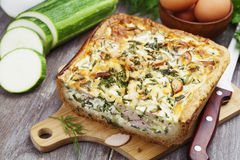 Pie with zucchini, sausage and herbs Stock Photo