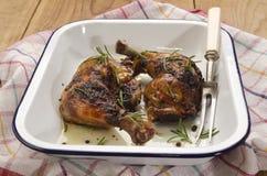 Piec kurczak nogi z rozmarynami Obrazy Stock