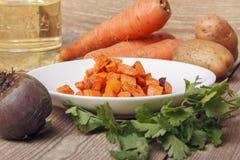 Piec marchewki dla jarzynowej sałatki Fotografia Royalty Free