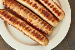 Piec na grillu kiełbasy na naczyniu Zdjęcie Royalty Free